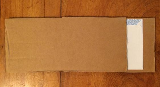How to Pack - Sandwich envelope between cardboard